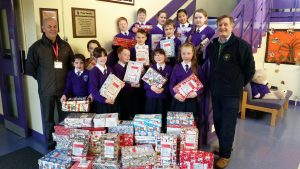 school-council-presenting-shoeboxes-to-representatives-of-the-samaritans-operation-christmas-child
